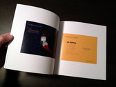 """""""A Private Encyclopaedia - Lyrics & Postcards from the debut album"""" Book photo"""