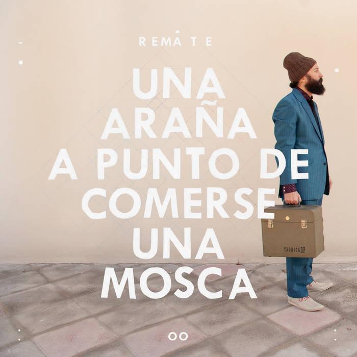 UNA ARAÑA A PUNTO DE COMERSE UNA MOSCA cover art