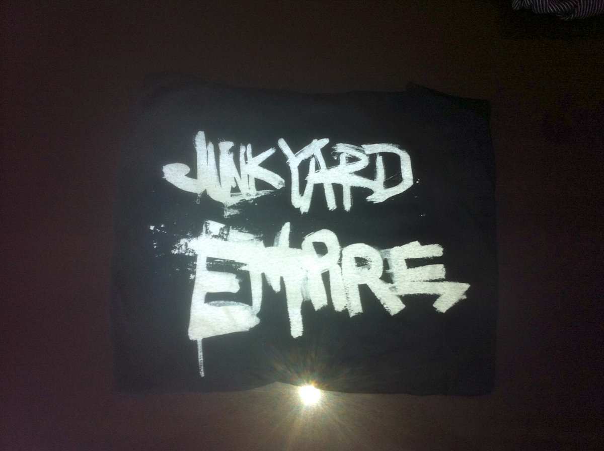 Acts of humanity vol 12 junkyard empire when you purchase this t shirt you will receive a free mp3 download of the album liner notes and the we want music video malvernweather Choice Image