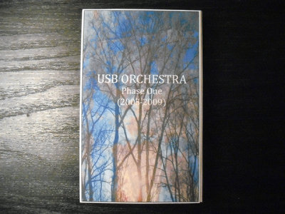 "AMOK050 - USB Orchestra - ""Phase One (2005-2009)"" CASSETTE main photo"