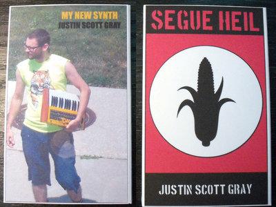 "AMOK047 / AMOK045 - justin scott gray - ""My New Synth"" & ""Segue Heil"" SPLIT CASSETTE main photo"