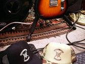 HTK Trucker hat - Black with white logo photo