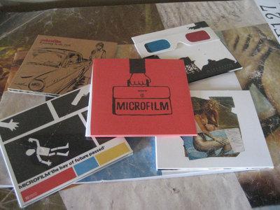 Microfilm Discographie Complète / 5 Cds + Affiche main photo