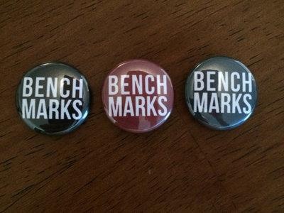 Benchmarks button main photo