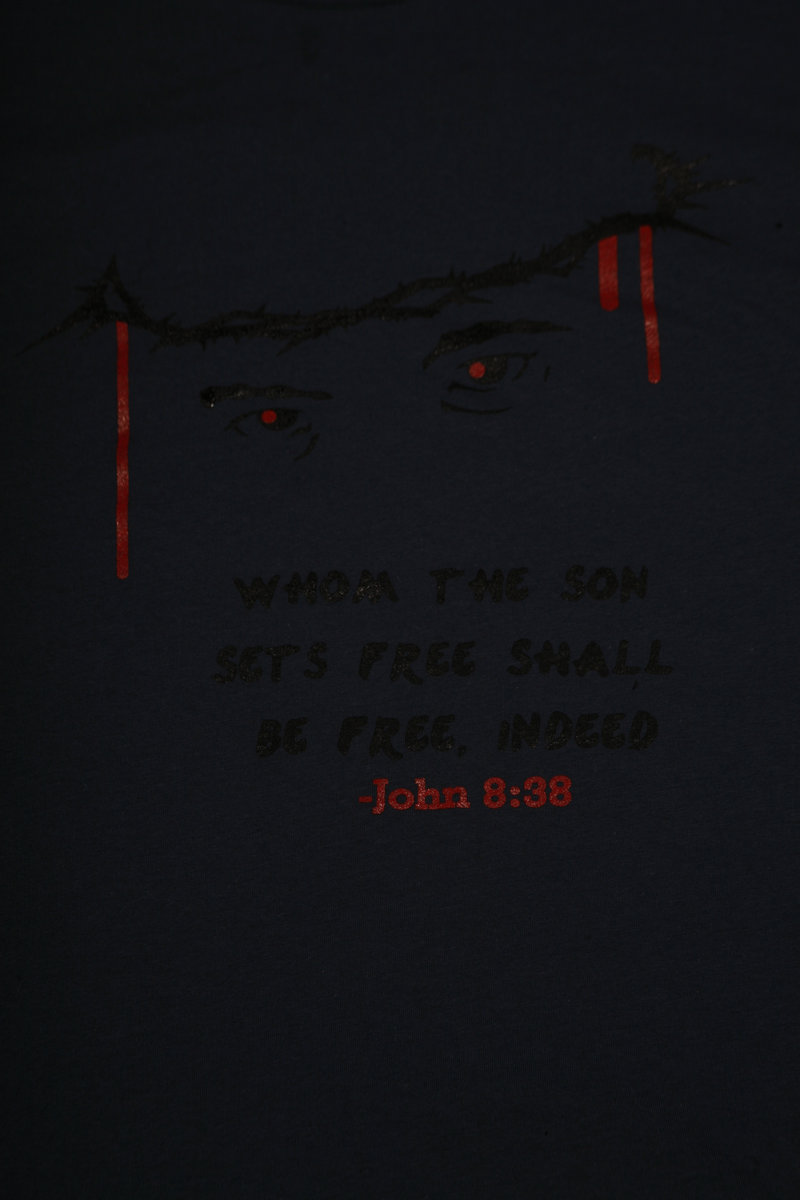 b760fb7dd This graphic t-shirt features scripture from the gospel of John (8:38) that  reads