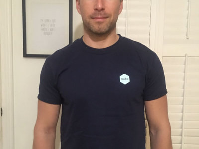 The Blue Tee shirt with the small badge logo main photo