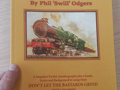 Paperback book: Tales From The Tracks - A Partial Biography and Songbook covering 'Don't Let The Bastards Grind You Down' and 'Roll To The Left' main photo