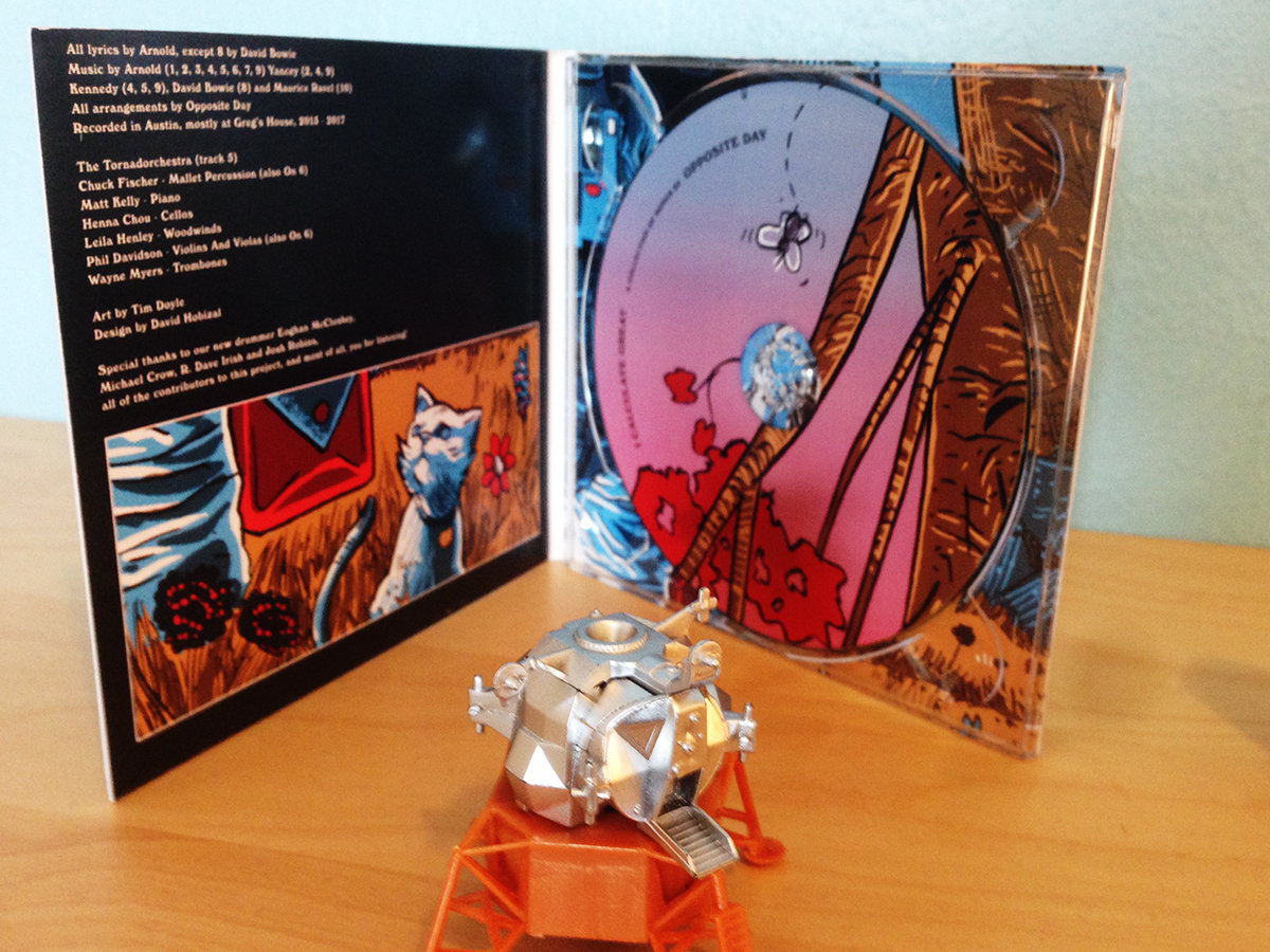 do over utopia opposite day beautiful cd design by david hobizal based on artwork by tim doyle makes a great meal for a robot toy for a mutant cat or ballast for your