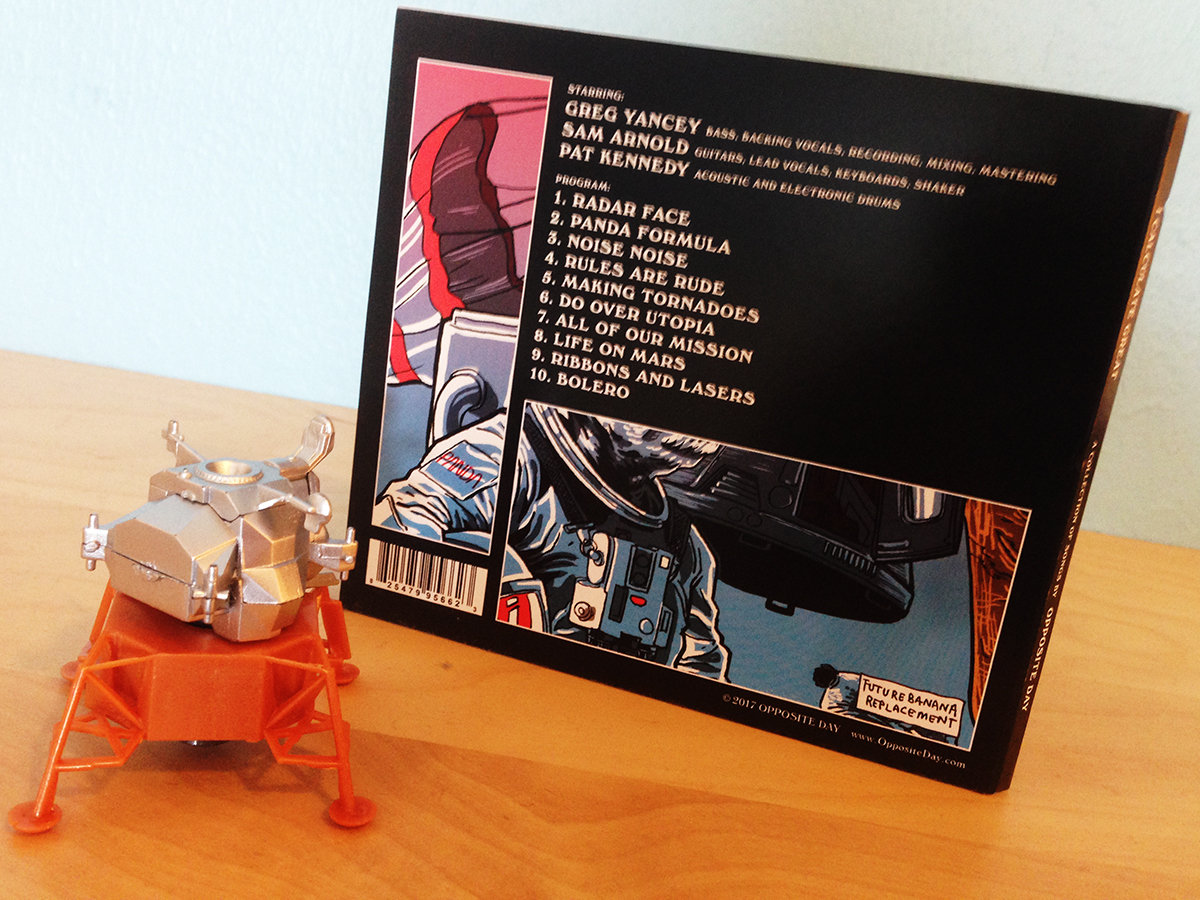 i calculate great opposite day beautiful cd design by david hobizal based on artwork by tim doyle makes a great meal for a robot toy for a mutant cat or ballast for your