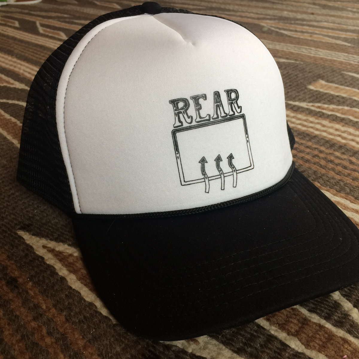 0b19cdf48774f Black and white trucker hat with classic rear defroster logo