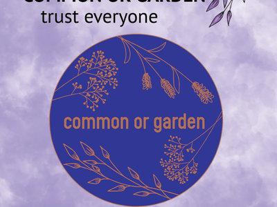 Common or Garden enamel badge on card backer main photo