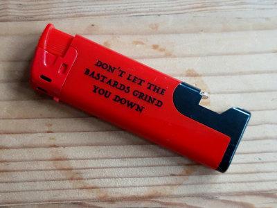 DON'T LET THE BASTARDS GRIND YOU DOWN : Bottle Opener / Lighter main photo