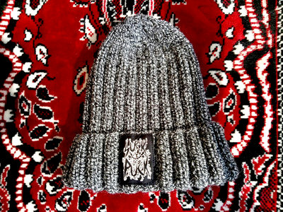 """Hand-knitted hat with """"Suck Puck Logo"""" print. main photo"""