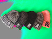 """Hand-knitted hat with """"Suck Puck Logo"""" print. photo"""
