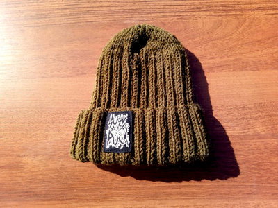 "Hand-knitted beanie with ""Suck Puck logo"" print. main photo"