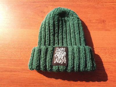 "Girl Hand-knitted hat with ""Suck Puck Stamp"" print. main photo"