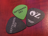 Autographed Guitar Pick with Wristband photo