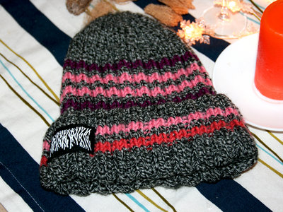 "Hand-knitted beanie with ""SuckPuck Death Rave"" print main photo"