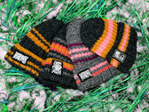 "Hand-knitted beanie with ""SuckPuck Death Rave"" print photo"