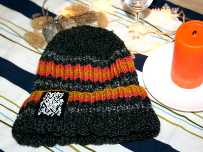 "Hand-knitted beanie with ""SuckPuck logo"" print main photo"