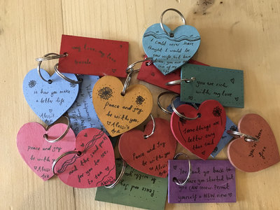 Hand painted wooden lyric keyrings main photo