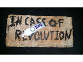 IN CASE OF REVOLUTION USB release attached to a brick photo