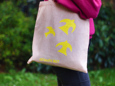 Pink cotton tote bag with hand printed yellow birds dyed with Avocado stones main photo