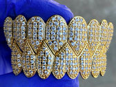 Iced Out Gold Shark Grillz Set photo